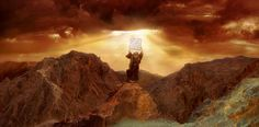 <b>Moses</b> raises <b>the ten commandments</b> above his head in rage
