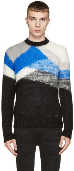Long sleeve knit sweater in tones of grey, marled blue, and black. Ribbed knit crewneck collar, cuffs, and hem. Logo plaque at front hem. Tonal stitching.
