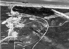 Vue aérienne de l'USAF du WN62 Omaha Beach vers 13h30 (NA/USA). On distingue un grand nombre de GI morts sur la plage.