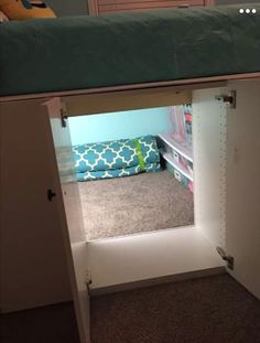 IKEA cabinets made into secret space for kids under bed