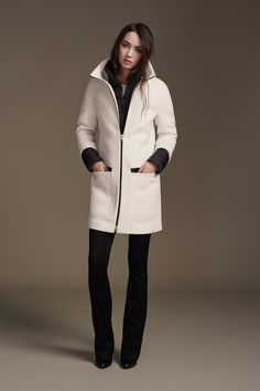 LETIZIA is a semi-fitted, mid length coat in classic wool with a stretch lining. Features built in puffy collar, cuffs and vest for extra warmth. Leather trim and contrasting black metal zippers create an element of drama in this timeless piece. Discover at http://www.soiakyo.com/ca/en/letizia-semi-fitted-wool-coat-with-puffy-bib-in-vanilla-for-women