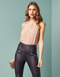 This Lipsy body top features a high neck with ruffle details at the edge. Pair with a pencil skirt or PU pants and courts for a chic evening out.