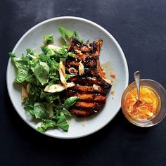One citrusy, chile-laced, and very hard-working marinade serves two functions, flavoring the pork chops before and after they hit the grill.