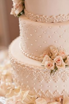 Beautiful Blush Wedding Cake. Love the lace borders.