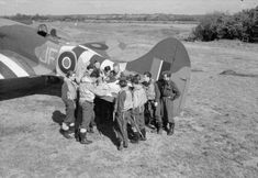 3 Squadron RAF Tempest and air crew during a pre-mission briefing, during the Battle of Normandy, 1944 Hawker Tempest, Battle Of Normandy, Hawker Typhoon, Airplane Art, Royal Air Force, Fighter Aircraft, World War, Wwii, Britain