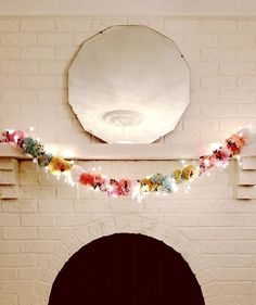 Pom-Pom Garland: Make a DIY pom-pom garland that's darling enough to stay up all year long.  Your mantel and doorways will thank you. Source: Design Sponge