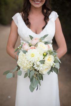 dahlia, garden rose, and eucalyptus bouquet, photo by Katrina Louise http://ruffledblog.com/secluded-garden-estate-wedding #flowers #weddingbouquet