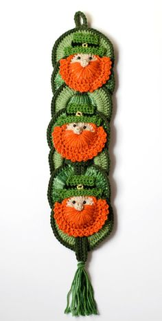 Celebrate St Patricks Day with this great St Pattys wallhanging! Hang it from a wall or your door! I love making holiday themed decorations. Easy to make and doesnt use a lot of yarn. Makes a fantastic gift--but dont forget to make one for yourself!  Materials Needed: - Worsted Weight Yarn (A great stash buster ) - Crochet Hook Size H - Canning jar rings (sources given; I used silicone jar rings purchased locally) - Small buttons for eyes - Tapestry Needle, sewing needle and thread for…