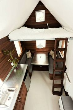 A modern take on the Tiny House idea, fantastic for those that like Brown and Stainless Steel...would love to have this for camping and pull it on wheels!