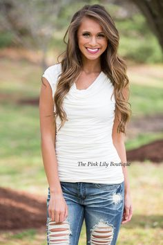This adorable blouse is made for memorable days! It features cap sleeves, ruched fabric, and a scoopneck. The white fabric is lightweight and soft, making it easy to wear this all day long!