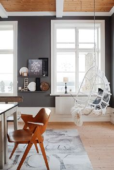 Darker wood ceiling planks contrasted with the white