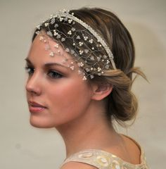 Calliope bridal headpiece £140. Crystal/pearl colour options available on request. This beautiful headpiece is made with Crystallised ™ Swarovski elements pearl and crystal suspended amongst silver wire and falls perfectly on the forehead on an ivory ribbon headband. Finished with Swarovski crystal along the headband. A delicate yet stunning headpiece. Delicate crystals and pearls have been hand woven into small pretty 3 leaf flowers to give a touch of sparkle and a touch of classic…