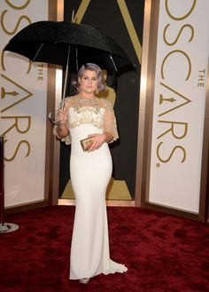 Dear Kelly, it would have been fine without that tacky umbrella...that ruins the beautiful gown.   PS Ditch those tacky tattoos on your arms, too! You look like a sailor. I'm told laser works a treat, and you can afford it.   Oscars 2014 Red Carpet: All The Dresses At The Academy Awards (PHOTOS, VIDEOS)