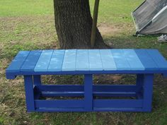 Outdoor Bench. Based on a rainbow colored bench I saw on Pinterest, we built this lovely bench for the yard. It is made with recycled wood a local construction project gave us. We spent money on paint, but it was under $20, I was able to purchase sample size paints from Lowe's which allowed me to use multiple colors. I love it sitting here under the tree.