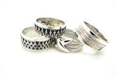 Ornate silver wedding bands