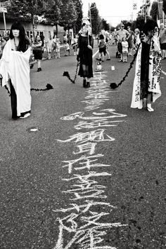 "8/9/2013 ""Live Calligraphy and Butoh performance: Heart Sutra on the Road"", at Greenwood Street Fair. The memorial day of Nagasaki. Calligraphy by Yoshiko Higashimura with Kaoru Okumura, et. al. Photo by Tomoko Jones"