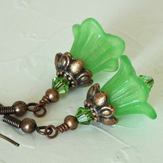 Lovely green lucite flowers with green Swarovski crystals and copper findings. $14.00