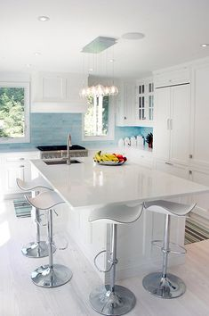 white/blue kitchen. Love the lights over the island.