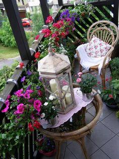 balcony design ideas decoration ideas petunias wood railing lantern balcony furniture