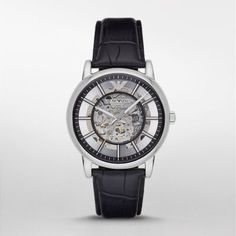 Dress Watch This stainless-steel men's Emporio Armani watch features a transparent skeleton dial with a…
