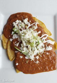 Chorizo Enfrijoladas con Queso with Cacique Oaxaca cheese, Beef Chorizo, Queso Blanco, and Crema Mexicana