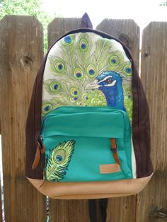 Hand Painted Peacock Canvas Backpack by Wishartist Painting Backpack, Canvas Backpack, Backpack Bags, Canvas Tote Bags, Painted Canvas Bags, Peacock Canvas, Peacock Purse, Easy Canvas Painting, Diy Tote Bag