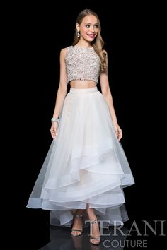 Two+piece+prom+dress+with+crystal+encrusted+crop+top.+The+prom+dress+is+finished+with+a+tulle+layer+skirt.