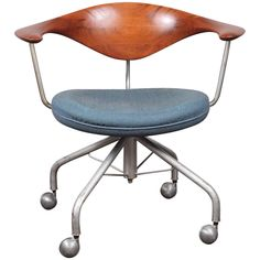 1955 Hans Wegner Swivel Chair | From a unique collection of antique and modern chairs at https://www.1stdibs.com/furniture/seating/chairs/