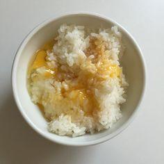 "Tamago-kake-gohan (aka ""TKG""). A bowl of rice. An egg. Soy sauce [optional]"