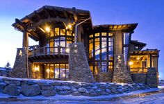 Rustic log cabin with lots of stone.  But use classic contemporary or transitional furniture.