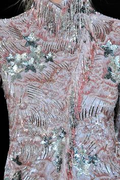Elaborate bead embroidery and sequin designs on kimono-style dress.