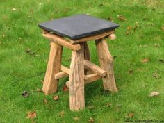 Slate and Oak Hobbit Chair - These funky little chairs are a combination of old oak fenceposts, bone oak, collected from fallen trees and slate for the seat,all held together by wooden dowels. Sturdy in design, these hobbit stools are great for in or outdoors - rain or shine!