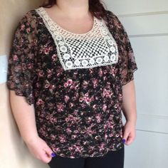 Floral blouse Black blouse with pink and purple roses on it. It has embroidery at the neckline. Flowy and lightweight. It is sheer. 100% polyester. New with tags. I'm modeling as 18/20, 40 f/g, 5'7. Julie's Closet  Tops Blouses
