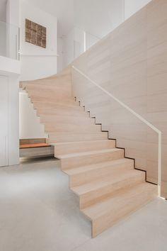 Contekst combines oak, stone and concrete inside a minimal Belgian house.