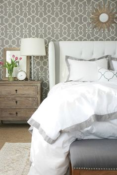 Master Bedroom: Layers of Bedding as seen in A Thoughtful Place and wall paper on one wall.
