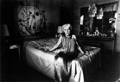 Peggy Guggenheim in a Fortuny Delphos in her Venice palazzo, c. 1979.
