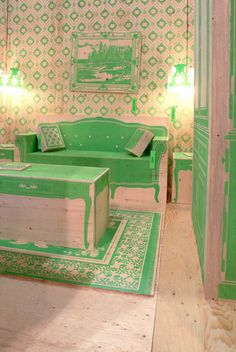 This is a plywood and trope l'oeil living room. Not a very cozy sofa but darn clever! green couch