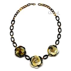 A beautiful chain necklace handmade from buffalo horn. High polish finish. Lightweight. Actual colors may vary. 29.92 (76cm) length. Link: 0.87 (2.2cm) length x 0.63 (1.6cm) width. Flower: 2.24 (5.7cm) diameter.