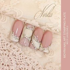 Proucts used: Base: Moyra Fuse One-Step Gel Lac No. 23 and No. 45 Decoration: gold Moyra Magic Foil, Moyra Stamping Nail Polish SP 07 White,  Moyra Crystal Stones and Moyra Pearl Rhinestones The Moyra stamping plate used for decoration is No. 31 Lacelove 2. #moyra #nailart #stamping #plate #lacelove2 #stampingpolish #fuse #onestep  #gellac #crystalstone #pearl #rhinestones