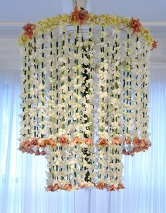 flower garland chandelier. #party #wedding #decor