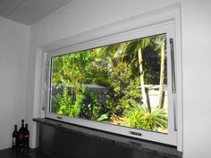 GAS STRUT WINDOW - Vision Solutions Glass and Aluminium Garage Door Windows, House Windows, Indoor Outdoor Kitchen, Outdoor Kitchens, Kitchen Diner Extension, Glass And Aluminium, Backyard Makeover, Pool Houses, Beautiful Interiors