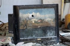 A Palestinian man is reflected on a damaged television amid the ruins of homes destroyed during the 50-day war between Israel and Hamas-led militants. A total of 30 aid agencies said last week that they were alarmed by the limited progress that had been made to rebuild devastated lives and tackle the root causes of the conflict.
