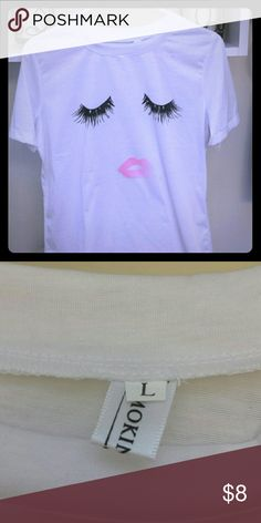 SUPER CUTE !!Eyelash and pink lip tee shirt 💋 💋 Bright white so my tee.  runs small two sizes available  Absolutely adorable with shorts and jeans. I have one myself  size  large ( i usually wear medium) soooooo many compliments! 🌷🌷🌷🎁🎁🎁 Tops Tees - Short Sleeve