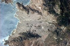 """Chris Hadfield 10 May """"Athens, Greece, with the reflecting sun showing the wind on the water. Back Photos, Cool Photos, Chris Hadfield, Earth Photos, Earth From Space, Upload Pictures, Athens Greece, Planet Earth, Wonders Of The World"""