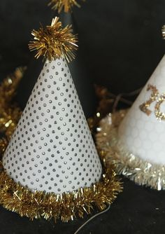 Use leftover gold tinsel to glam up patterned hats for your New Year's Eve party.