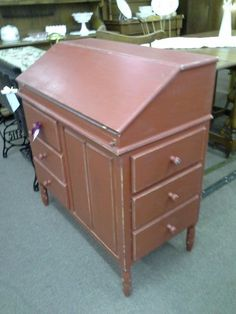 SOLD - This is a solid pine desk. The drop front has cubbies inside. Three drawers below the desk ad well as three more drawers that open on the side of the desk. It measures 33 inches across the front, 18 inches deep and stands 36 inches tall.  It can be seen in booth D 2 at Main Street Antique Mall 7260 East Main St ( E of Power Rd ) Mesa 85207  480 9241122open 7 days 10 till 530 Cash or charge 30 day layaway also available