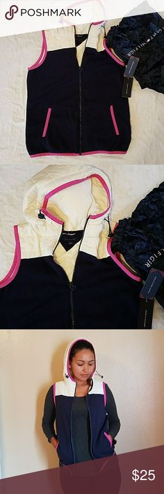 Tommy Hilfiger light vest Navy blue cotton material,pink trimming, off white top and back of vest. It's from their athletic line. Brand new with tags! Come with small tommy hilfiger tote bag!! Tommy Hilfiger Jackets & Coats Vests