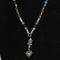 Check out this item in my Etsy shop https://www.etsy.com/listing/264233823/beaded-necklace-turquoise-and-silver