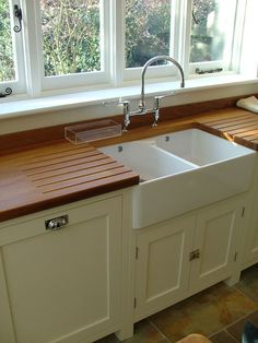 Love the sink, taps and drainer here: Under mounted Belfast sink with built in worktop draining grooves Kitchen Inspirations, Kitchen Worktop, Kitchen Space, Home Kitchens, Shaker Kitchen Design, Shaker Kitchen, Kitchen Design, Best Kitchen Countertops, Kitchen Remodel