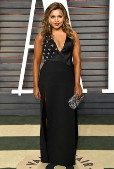 MINDY KALING changes into a sleeker number by Mindy Project costume designer Salvador Perez, worn with Neil Lane jewelry and an Oroton clutch  2016 Vanity Fair Oscar Party.